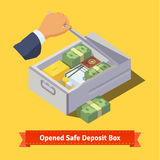 Hand opening a safe deposit box full of valuables Royalty Free Stock Images