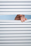 Hand Opening Shutters or Blinds Stock Images