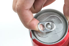 a hand opening soda or beer can. Isolated on white background. Stock Images