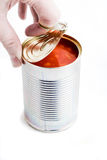 Hand opening tin can Royalty Free Stock Photos