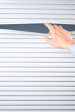 Hand Opening Venetian Blinds Stock Photography