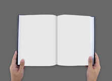 Hand opening white journal with blank pages mockup. Magazine template mock up Royalty Free Stock Photo