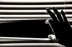 Hand opening windows blinds Stock Image