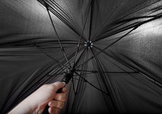 Hand opens big black umbrella Royalty Free Stock Photo