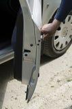 Hand opens a car door Stock Image