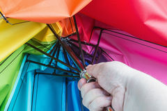 Hand opens a colorful umbrella Royalty Free Stock Image