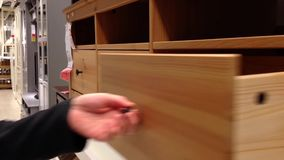 A hand opens a drawer in cabinet Royalty Free Stock Photos