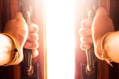 Hand opens empty room door Stock Photos