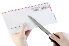 Hand opens the envelope Stock Photo
