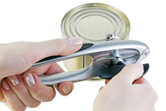 Hand opens a jar of canned food Stock Image