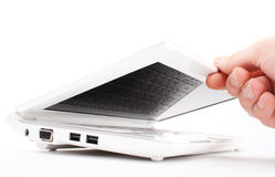The hand opens laptop Stock Photography