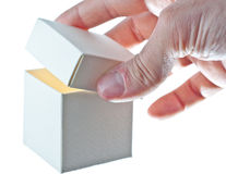 An hand opens a paper box. Open paper box on white background royalty free stock photography