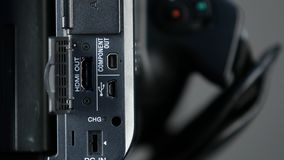 Hand opens usb, hdmi, component out video outputs of camera, close up stock footage