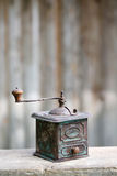 Hand-operated old metallic coffee or spices grinder Stock Image