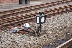Hand-operated railroad switch with lever. Weight and signal royalty free stock images