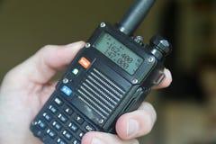 Hand operating amateur radio walkie talkie stock photography