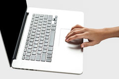 Hand operating a brand new laptop Stock Photography