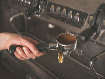 Hand operating coffee machine Stock Photos