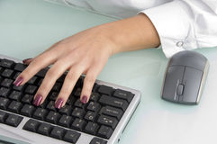 Hand operating keyboard Royalty Free Stock Photo