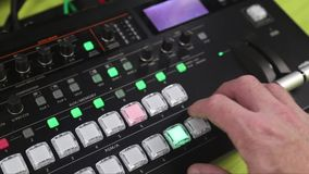Hand operating Video production switcher used for live events stock video
