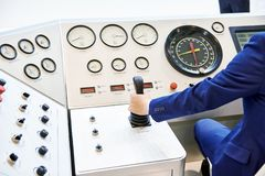 Hand operator with joystick control oil equipment. Hand operator with joystick control of production oil equipment royalty free stock images