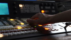 The Hand of an Operator Presses Button and Mix on the Broadcasting Console stock video footage