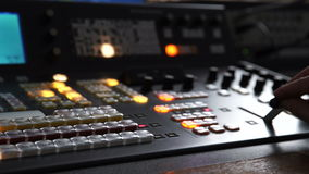 The Hand of an Operator Presses the Mix on the Broadcasting Console stock footage