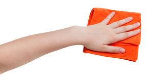 Hand with orange dusting rag isolated on whit Stock Photo