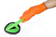 Hand with orange glove cleaning with brush. Royalty Free Stock Photos