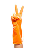 Hand in orange glove count to two Royalty Free Stock Photo