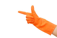 Hand with orange glove pointing hand to something Royalty Free Stock Photography