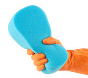 Hand in orange glove with sponge Stock Images