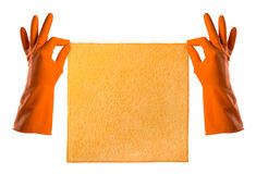 Hand in orange rubber glove holds a orange rag - house cleaning Royalty Free Stock Photos