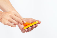 Hand with orange stickers on white background Royalty Free Stock Photography