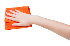 Hand with orange wiping rag isolated on white Royalty Free Stock Photo