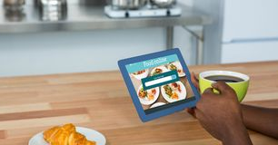 Hand ordering food using digital tablet while having coffee. Digital composite of Hand ordering food using digital tablet while having coffee Stock Photography