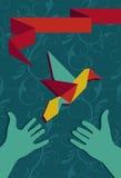 Hand and origami hummingbird Royalty Free Stock Photography