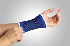 Hand with a orthopedic wrist brace Stock Photos