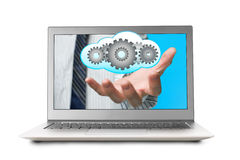 Hand out front laptop screen with cloud and gears Royalty Free Stock Image