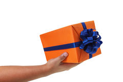 Hand out large gift wrapped Stock Image