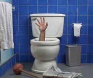 Hand out of the toilet Royalty Free Stock Image
