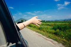 Hand out the window Stock Photos
