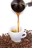 Hand outpouring coffee Royalty Free Stock Photos