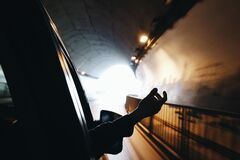 Hand outside car in tunnel Royalty Free Stock Image