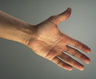 Hand outstretched Royalty Free Stock Photography