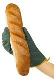 Hand in Oven Mitt Holding French Baguette Stock Photo