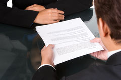 Hand over agreement. A business man give an agreement document to customer Royalty Free Stock Images
