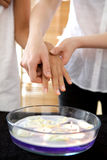 Hand over bowl filled with candles Stock Image