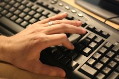 Hand over computer keyboard. Serching Royalty Free Stock Photos
