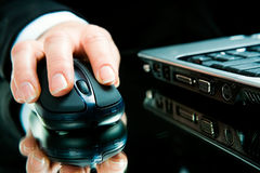 Hand over computer mouse Stock Images